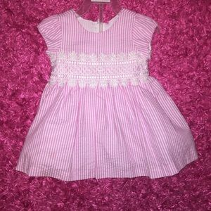 Pink striped seersucker baby girl dress with lace
